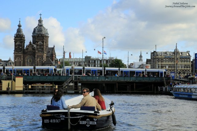 Boat tour in the canals of Amsterdam in The Netherlands