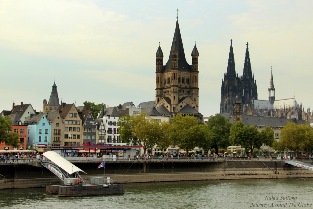 Cologne city from our cruise boat on River Rhine in Germany
