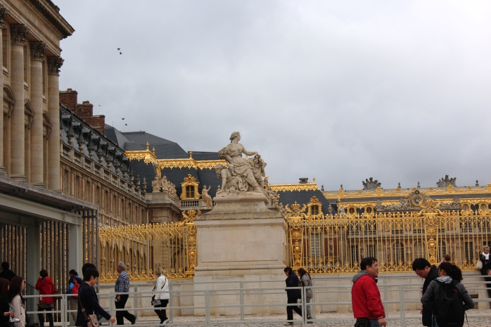 Statue near the main entrance of Versailles Palace in France