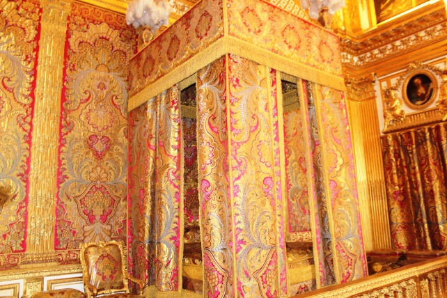 King's Bedroom in Versailles Palace, which was created by Louis XIV and he lived here until his death in 1715