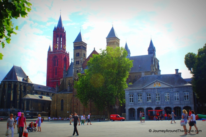St. Jan's Church on the left with red tower and Basilica of St. Severatius on the right, Maastricht, The Netherlands