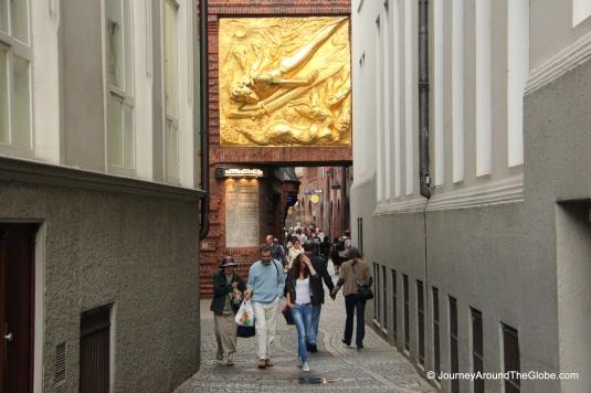 Entering Bottcherstrasse - a golden gilt adorning the gate, Bremen, Germany