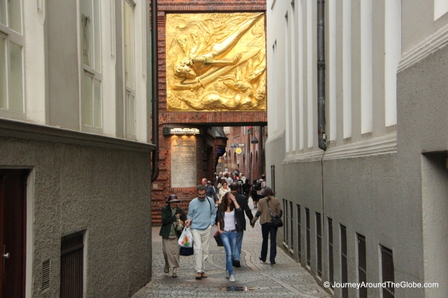 Entering Bottcherstrasse - a golden gilt adorning the gate, Bremen, Germany