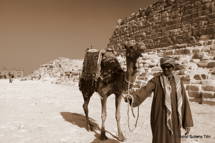 A random poser in Giza, who later asked for money since he posed for my camera and he was the one who kept insisting that I take picture of him and his camel