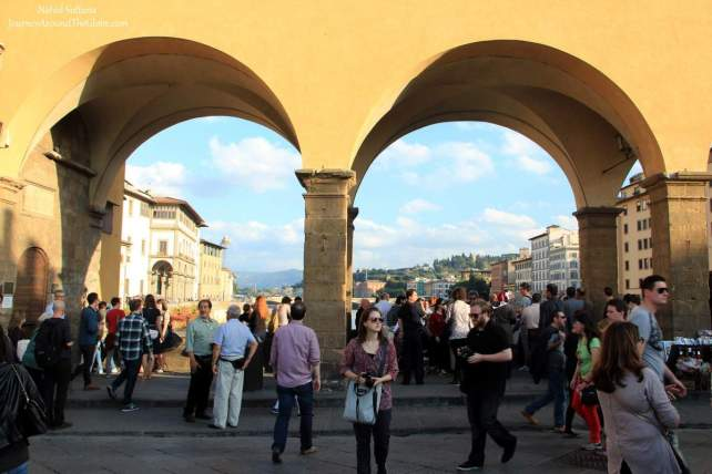Standing on Ponte Vecchio in Florence, Italy