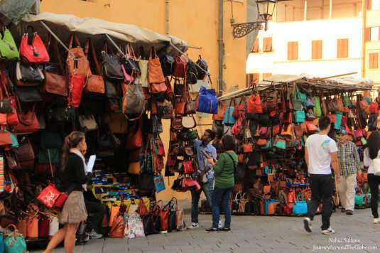 Purse vendors in Florence, Italy