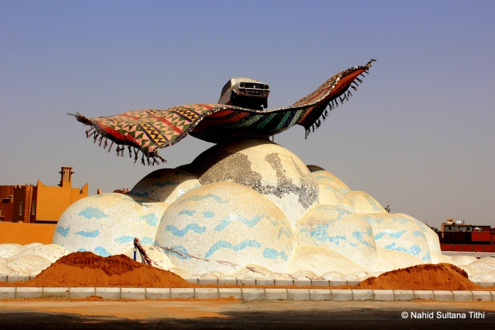 Car on a magic carpet...just a beautiful round-about in Jeddah