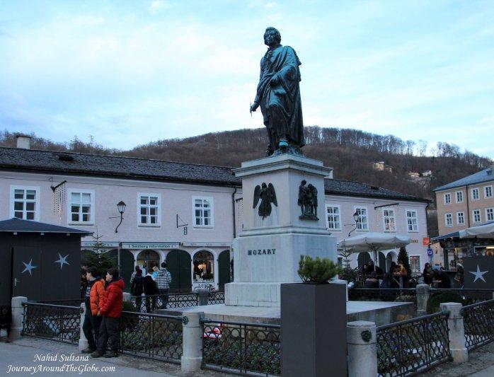 A statue of young Mozart in Mozartplatz, Salzburg, Austria