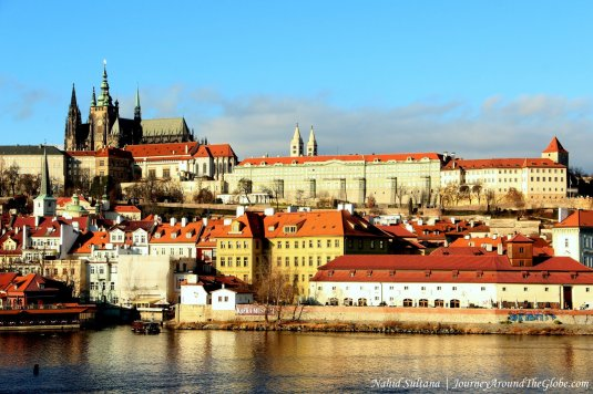 Steeples of St. Vitus Cathedral and Prague Castle from Charles Bridge in Prague
