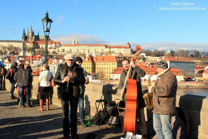 Bustling life of Charles Bridge during day