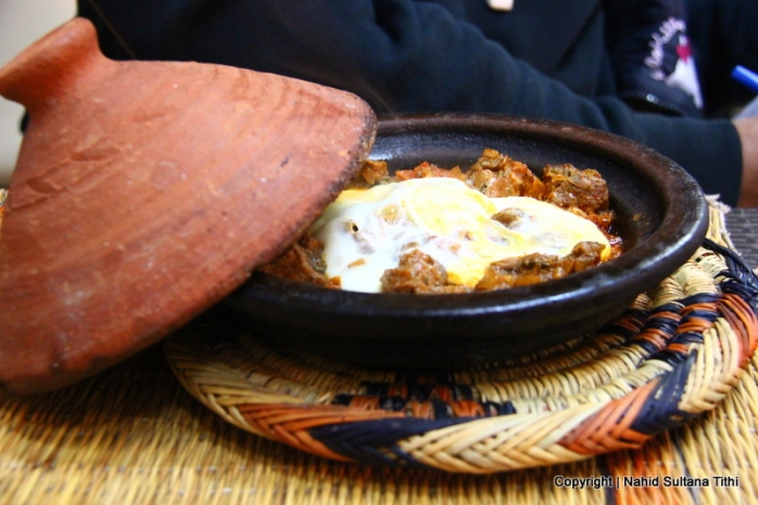 Our first dinner, traditional Moroccan Beef tagine with egg in a restaurant, Taj'in Darna, in Djemma El-Fna