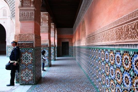 Calligraphic walls in main courtyard of Ben Youssef Madrassa in Marrakech, Morocco