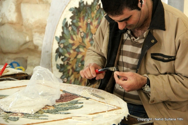 An artist working on a mosaic decor in Madaba Handcrafts Center, Jordan