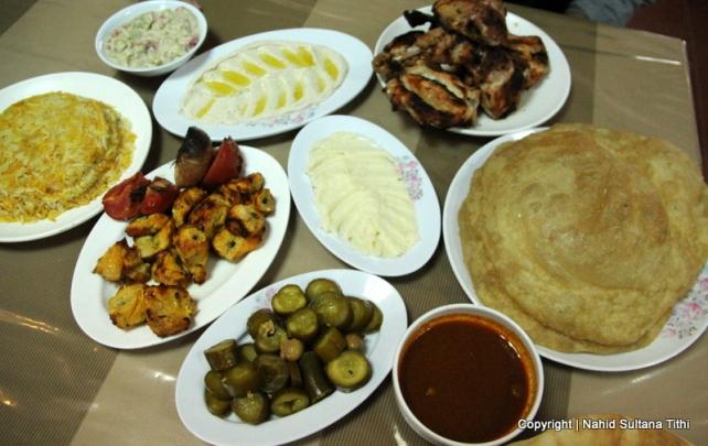 Lunch (chicken kebab, hummus, pickles, bread, and rice near Bethany, Jordan