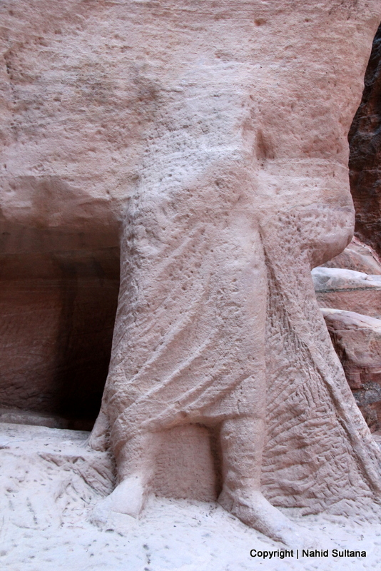 A 2000 years old statue carved from stone by Nabataean inside Siq in Petra, Jordan