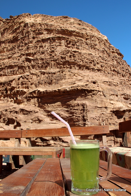 My glass of lemonade with a hint of mint on top of the mountain on our way to the monastery in Petra, Jordan