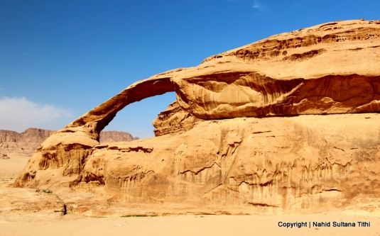 A natural rock bridge in Wadi Rum, Jordan