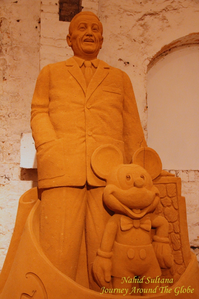 Sand Sculpture of Mr. Walt Disney and Mickey Mouse in Disney's Sand Magic in  Dinant Citadel, Belgium