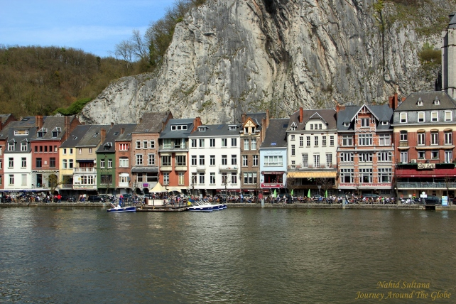 Old buildings by River Meuse in Dinant, Belgium