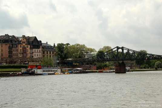 River Main and pedestrian Iron Bridge in Frankfurt, Germany