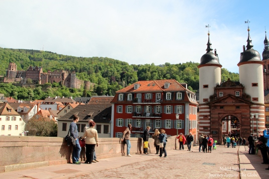 am Bruckentor (on the right), Heidelberg Castle on the hill on left...a view from Alte Brucke on River Necker in Heidelberg, Germany