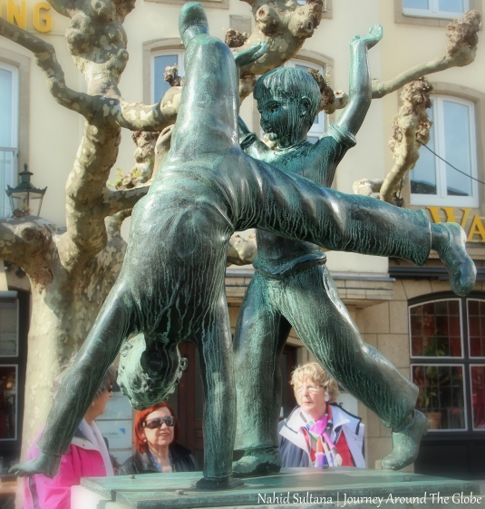 Cartwheeling statue in Burgplatz of Dusseldorf, Germany