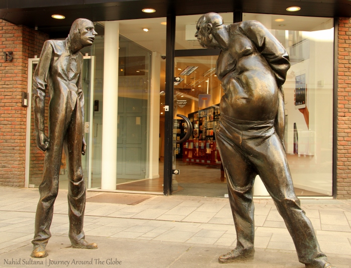 "A statue, known as ""Conflict"", in the old town of Dusseldorf, Germany"