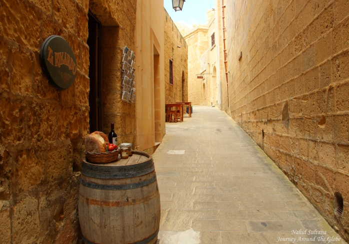 Walking by the old walls of Gozo Citadel in Gozo, Malta
