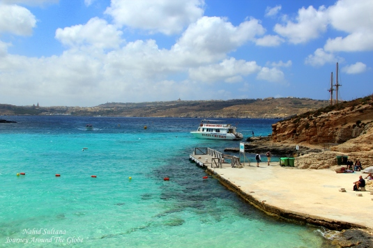 "Our boat ""Luzzu Cruise"" standing on the azure water of Blue Lagoon in Comino, Malta"