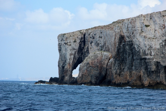 Elephant's trunk rock near Crystal Cave of Comino in Malta