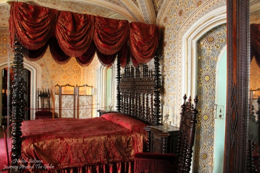 Richly decorated queen's bedroom in Pena Palace in Sintra, Portugal