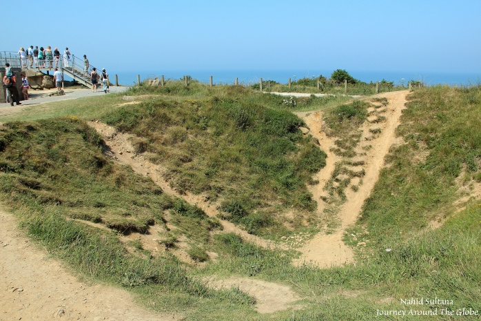 One of many craters that were created due to aerial bombings on Pointe du Hoc during D-day invasion in Normandy, France