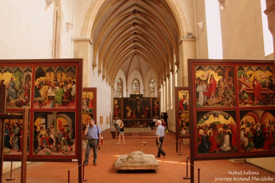 Lots of religious paintings inside Unterlinden Museum of Colmar, France