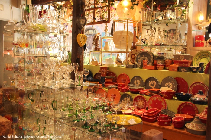 Alsatian potteries and typical looking wine glasses in a souvenir shop in Riquewihr, France
