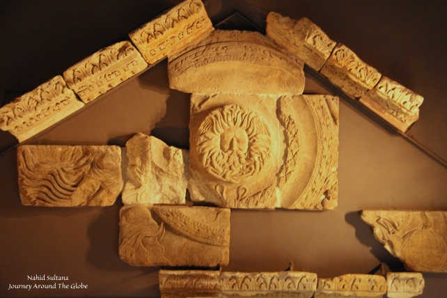 Ruins from Roman temple pediment featuring the Gorgon in Roman Baths of Bath, England