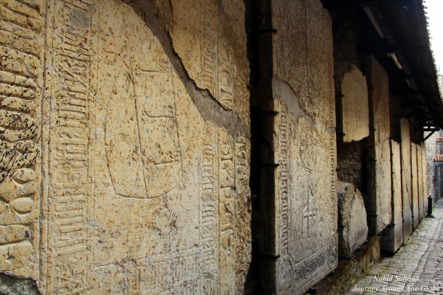 Medieval tombstones on the walls of St. Catherine's Passage in Tallinn, Estonia
