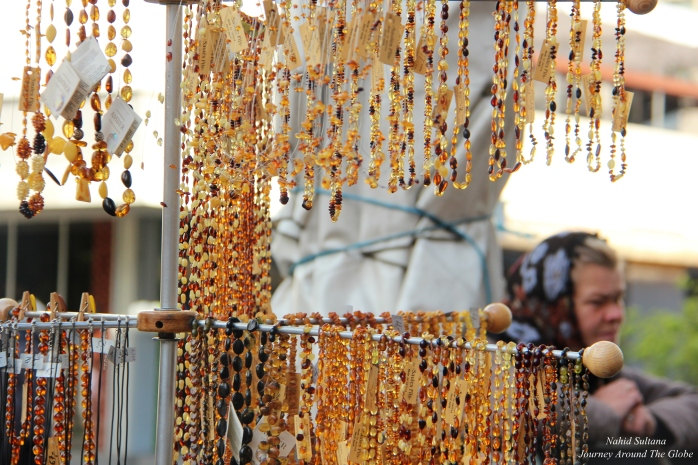 A street vendor selling amber jewelries in old town of Riga