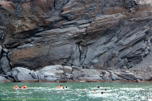 People swimming in the hot springs of Palea Kamini in Santorini