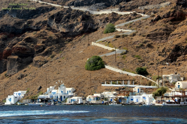 Harbor of Thirassia, you can see the white stairs going up the cliff