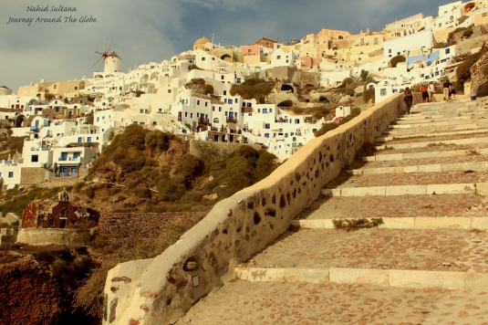 Climbing some 250 steps from Ammoudi Bay to Oia