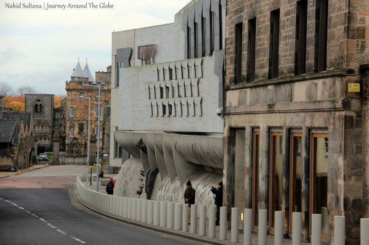 Royal Mile - the backbone of Old Edinburgh. Scottish Parliament (on the right) and Holyrood Palace (in the back)
