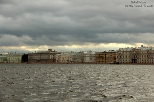 A line of historic palaces and old buildings by Neva River in St. Petersburg