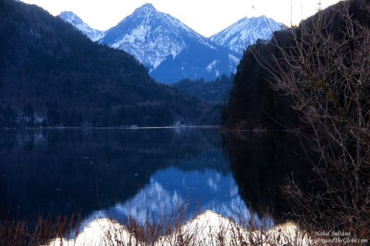 The Alps and its reflection on Lake Alpsee in Fussen, Germany