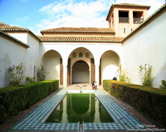 A patio with pool in Nasrid Palace of Alcazaba in Malaga, Spain