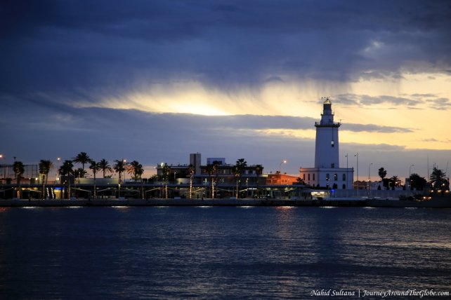 Lighthouse in Malaga Port before sunrise