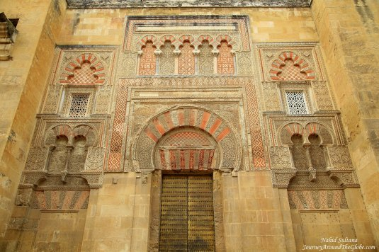 An old gate and exterior wall of Mezquita in Cordoba, Spain