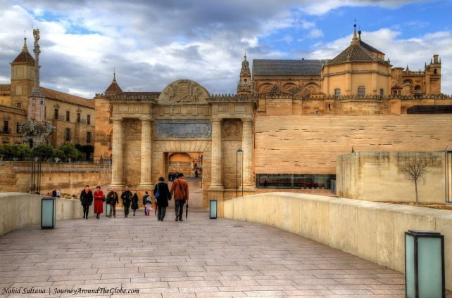 Walking on the Roman Bridge of Cordoba, Spain and looking at Mezquita