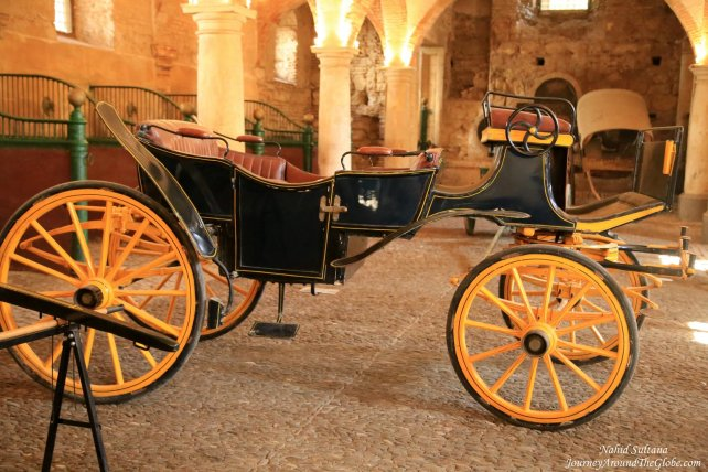 An old carriage inside the Royal Stable of Cordoba, in Spain