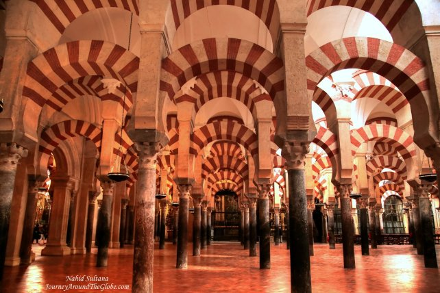 Red and white stripped arches of Mezquita - an original Moorish design from the 8th century