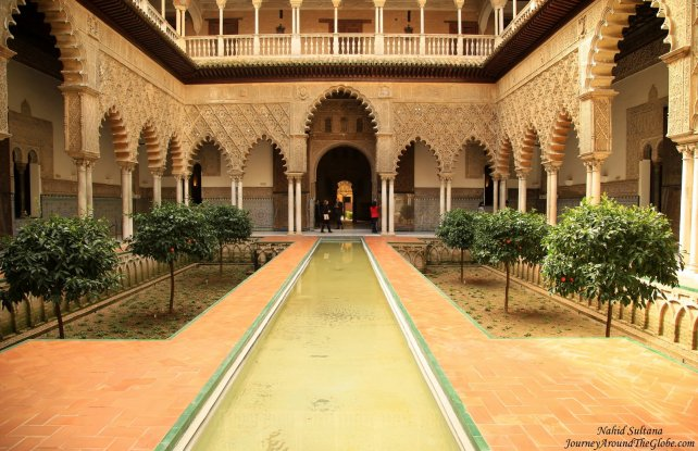 The most beautiful courtyard with pool of Real Alcazar in Seville, Spain